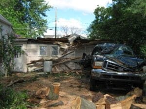 Tree damages to garage before pictures | Storm damage cleanup by Roth Companies and Roth Construction Company services water, fire, smoke damage restoration and remediation for Cleveland, Elyria, Akron, Canton, Sandusky, Youngstown, OH, Ohio areas