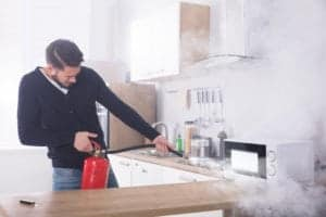 fire extinguisher provides kitchen safety when cooking Roth Companies and Roth Construction Company services water, fire, smoke damage restoration and remediation for Cleveland, Elyria, Akron, Canton, Sandusky, Youngstown, OH, Ohio areas