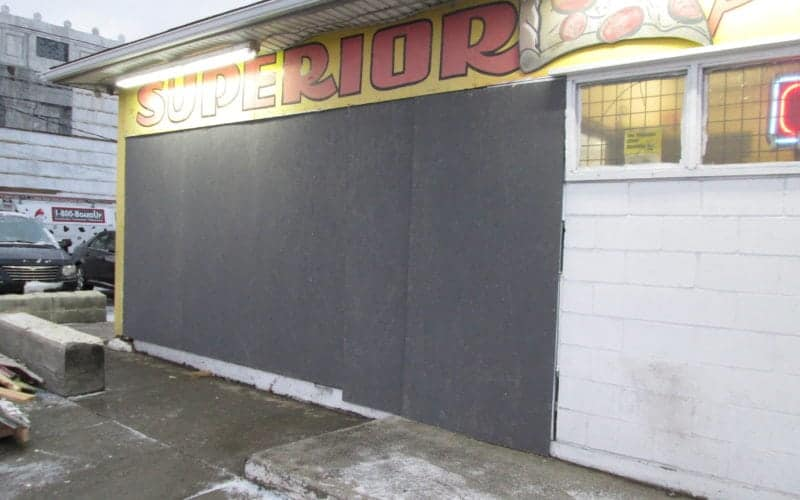 Boarded up Business front vehicle damage | Vehicle damage cleanup services by Roth Companies and Roth Construction Company services water, fire, smoke damage restoration and remediation for Cleveland, Elyria, Akron, Canton, Sandusky, Youngstown, OH, Ohio areas